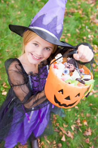 Halloween Candy Held by girl in purple witch costume